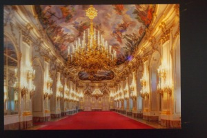 Photo of a postcard of the great hall in Schonbrunn castle