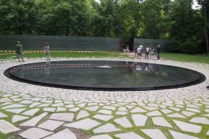 "The interesting design of the Sinti and Roma memorial. Names are inscribed on the white stones and a Roma poem is carved around the pool ""Sunken in face / extinguished eyes / cold lips / silence / a torn heart / without breath / without words / no tears"""