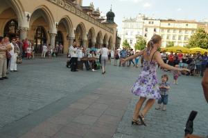 Music and dance in the main square captivate a child