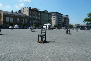 Giant chairs sculpture in the square in front of the Pharmacy Under the Eagle memorialising the Jews in the ghetto.