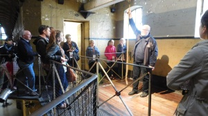 The guide explaining Ned Kelly's hanging at the actual scaffold
