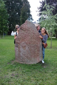 Girls and a rune stone in the park